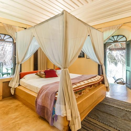 Luxury bedroom in villa with pool